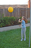 Im going to hit it. Child with tetherball royalty free stock images