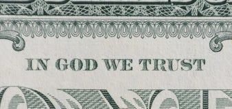 Im Gott vertrauen wir Stockbild