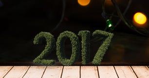 2017 im Gras auf hölzerner Planke gegen ein zusammengesetztes Bild 3D von Weihnachtslichtern Lizenzfreies Stockfoto