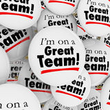 Im On a Great Team Buttons Pins Employees Group Pride. I'm on a Great Team words on many buttons or pins in a pile to be worn by members, staff or employees to Stock Images
