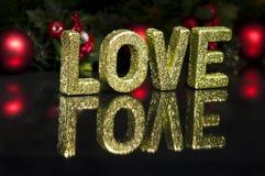 Im Großbuchstaben schriftlich Liebe, Funkelneffekt Stockbilder