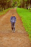 Im looking forward to the future. Little boy enjoy a brighter future. Little boy walk along footpath in park. Preparing. For the challenges of the future. The royalty free stock photos
