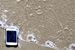 Im Sand-iPod-iPhone Stockbild