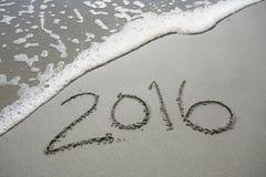 2016 im Sand am Strand Lizenzfreie Stockbilder