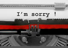 Im sorry text by the old typewriter on white paper. Im sorry text written by an old typewriter on white sheet stock photo
