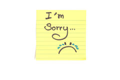 Im sorry. Top-view photo of small yellow stick note isolated on white background with sentence Im sorry Royalty Free Stock Photos