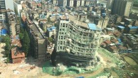 Im Stadtzentrum gelegener Gebäudeabbruch durch Implosion Lizenzfreie Stockbilder