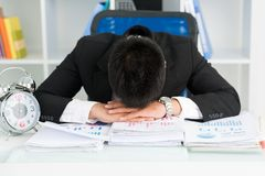 Im so tired!. Tired businessman putting head on the table Royalty Free Stock Image