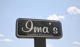 Ima`s Ladies Fashions. Ima`s is a retailer of ladies, pants, skirts, blouses, earrings, bracelets and other women`s fashions and accessories Royalty Free Stock Image