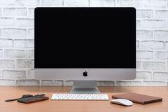 IMac computer, iPad mini, iPhone X and Apple Watch royalty free stock photos