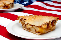 image of 2 pcs of apple pie on the American flag Royalty Free Stock Photo