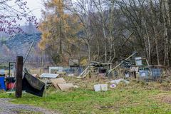 Image of an accumulation of objects and garbage in the middle of a field stock photography