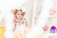Image of adorable girl posing in floral wreath Royalty Free Stock Image