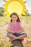 Image of adorable little girl in lotus position Royalty Free Stock Photos