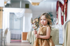 Image of adorable little girl posing with mask Stock Photo