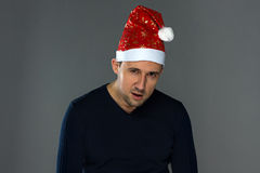 Image of adult serious man in christmas hat Stock Photos