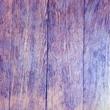 Aged rustic wooden background texture in violet color. Image of aged wooden background texture in purple or violet color Stock Photo
