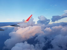 Image through aircraft window onto jet engine. And clouds Stock Photos