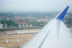Image of airplane wing in flight Royalty Free Stock Image