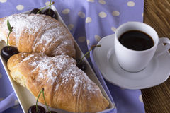 Image of alarm clock, hot coffee and croissants. Stock Photos
