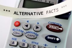An Image of `alternative facts ` written on alabeling device - Close up. An Image of ` alternative facts ` written on alabeling device - Close up - abstract royalty free stock image