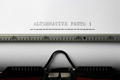 An Image of `alternative facts` written on a typewriter - Close up. Abstract stock photo