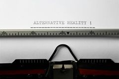 An Image of `alternative reality` written on a typewriter - Close up. Abstract stock photo