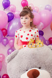 Image of amusing little girl with big teddy bear Stock Images