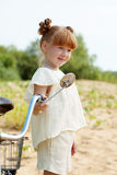 Image of amusing young girl posing with bicycle Stock Images