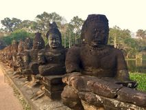 Hindu Gods and Demons. Stone statues. Cambodia . Image of ancient statues of gods at the South Gate of UNESCO& x27;s World Heritage Site of Angkor Thom, Siem stock image