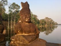 Giant Stone Face. Ancient Hindu Statues. Angkor Wat, Cambodia. stock photo