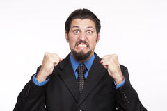 Image of a angry young businessman with clenched fist. Angry businessman with clenched fist Stock Images
