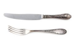 Image of antiquarian silver fork and knife Stock Image