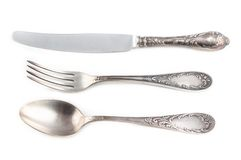 Image of antiquarian silver fork, spoon and knife Stock Photo