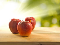 Image of apples on a green background Royalty Free Stock Images