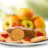 Image of apples and sweets on  sunlight background Stock Images