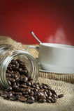 Image of Arabica Coffee Over red gradient background Stock Image