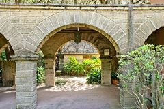 An archway on the grounds of the Gonzalez Alvarez House in Historic St. Augustine, Florida. This is an image of an archway on the grounds of the gardens on the Stock Photography