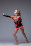 Image of artistic young girl dancing in studio Royalty Free Stock Photography