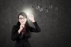 Asian businesswoman with a light bulb Stock Photo