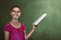 Image of asian female student holding book Stock Photo