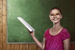 Image of asian female student holding book Royalty Free Stock Images