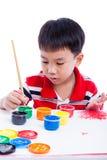 Image asiatique d'aspiration de garçon utilisant des instruments de dessin, conce de créativité Photos stock