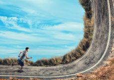 Athlete running on a bend road. Royalty Free Stock Photos