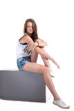 Image of athletic young girl sitting on cube Royalty Free Stock Photos