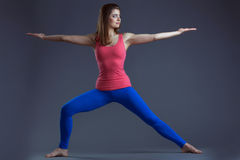 Image of athletic young woman balancing in studio Royalty Free Stock Photo