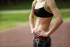 Image of athletic young woman with tight defined abs in stomach Royalty Free Stock Photo