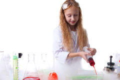 Image of attentive little scientist mixes reagents Stock Images