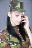 Image of attractive female soldier talking on cell phone Royalty Free Stock Images