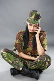 Image of attractive female soldier talking on cell phone Stock Photography